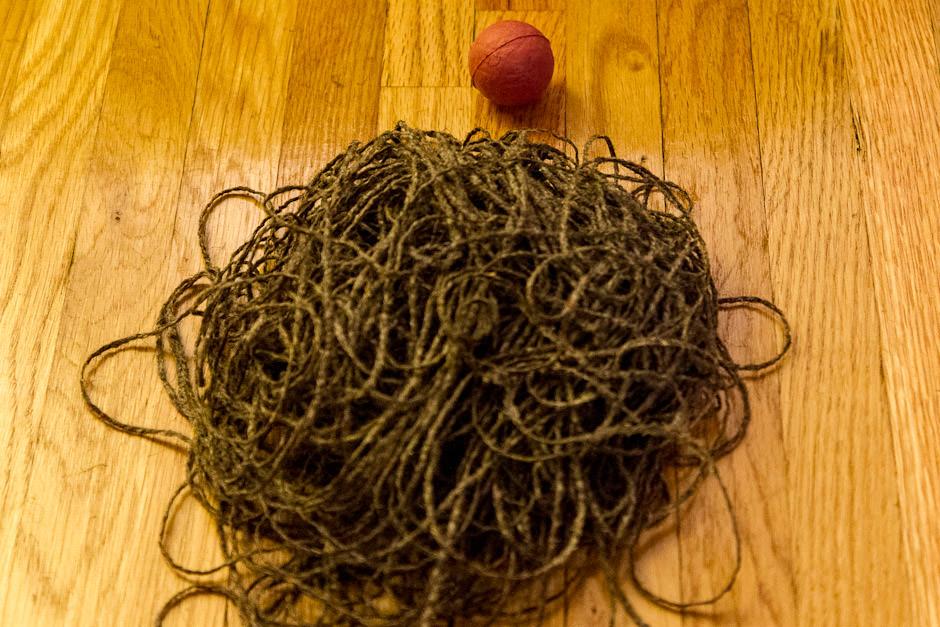 Baseball after 2nd layer of dark yarn removed