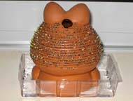 Rear view of Chia Pet after 1 week