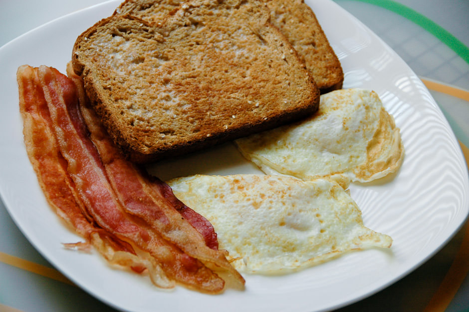 Fried eggs, bacon, and toast